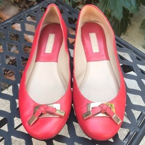 Michael Kors Poppy color red flats with Gold bow